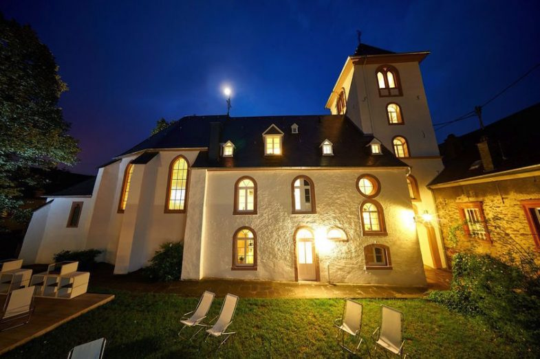 exterior image of lit-up old church in Bernkastel-Wehlen